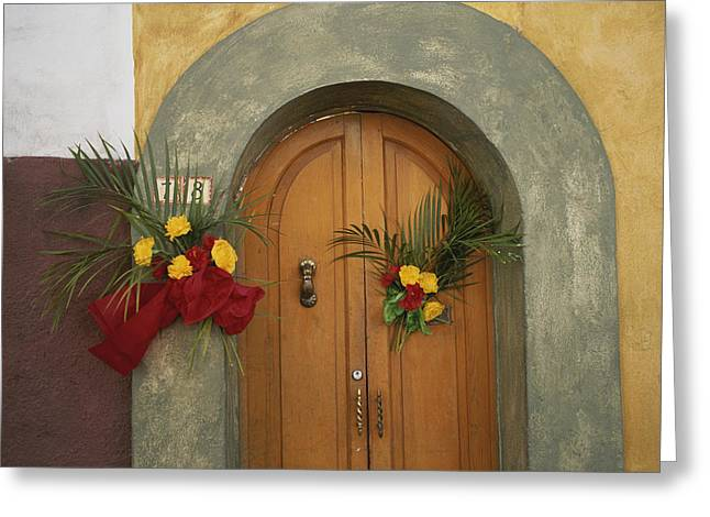 Doors And Doorways Greeting Cards - An Arched Doorway Adorned With Flowers Greeting Card by Raul Touzon