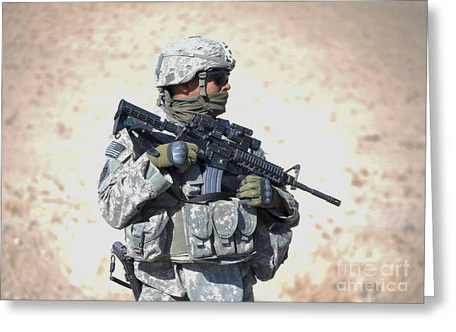 Zabul Greeting Cards - An Army Soldier Stands Guard While Greeting Card by Stocktrek Images