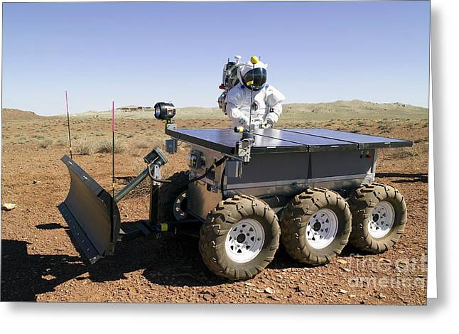 Cart Driving Greeting Cards - An Astronaut Drives An Electric Tractor Greeting Card by Stocktrek Images
