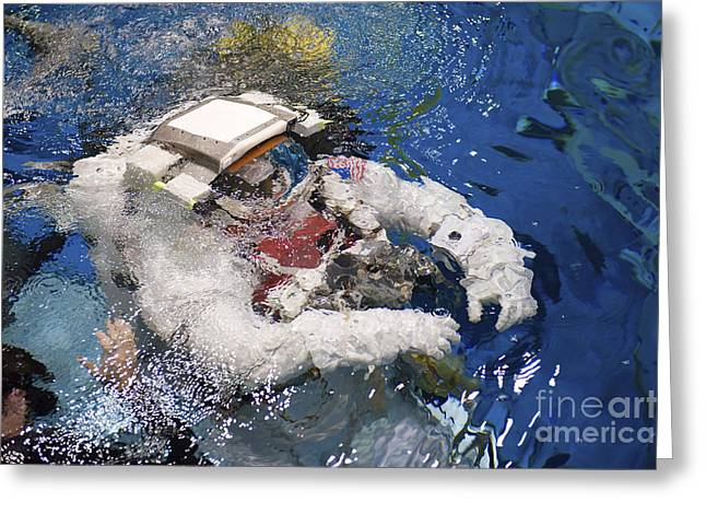 An Astronaut Is Submerged In The Water Greeting Card by Stocktrek Images