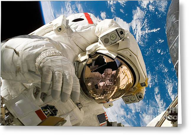Space Shuttle Photographs Greeting Cards - An Astronaut Mission Specialist Greeting Card by Stocktrek Images