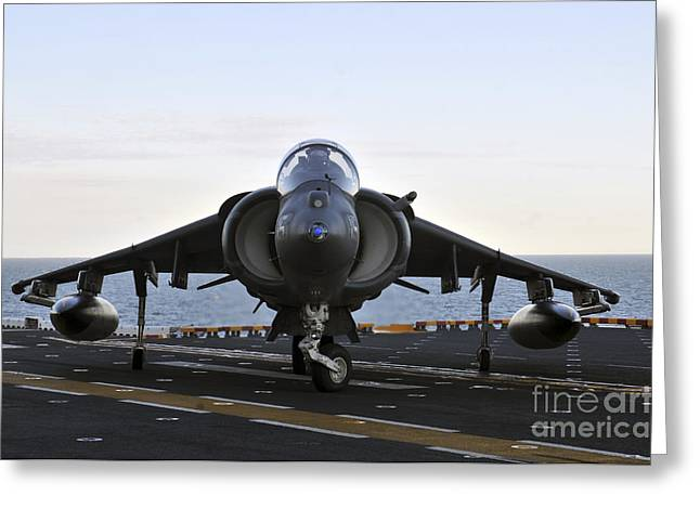 Military Airplanes Greeting Cards - An Av-8b Harrier Maneuvers Greeting Card by Stocktrek Images