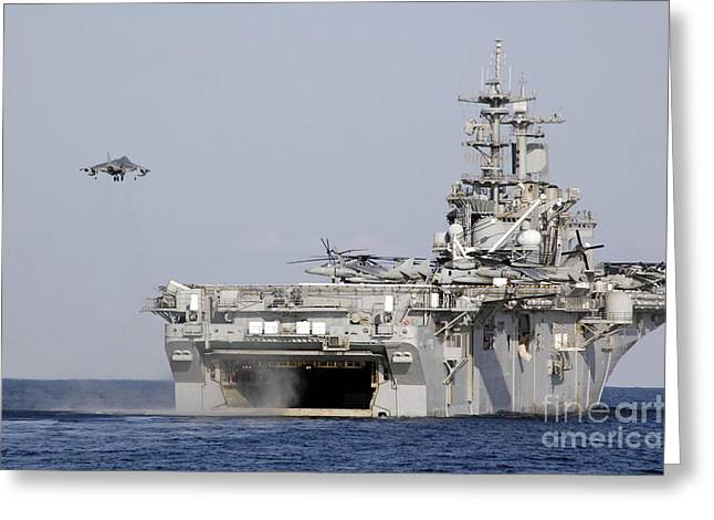 Uss Essex Greeting Cards - An Av-8b Harrier Prepares To Land Greeting Card by Stocktrek Images
