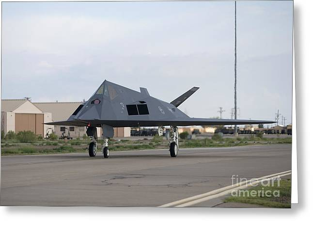 Taxiing Greeting Cards - An F-117 Nighthawk Taxis To The Runway Greeting Card by HIGH-G Productions