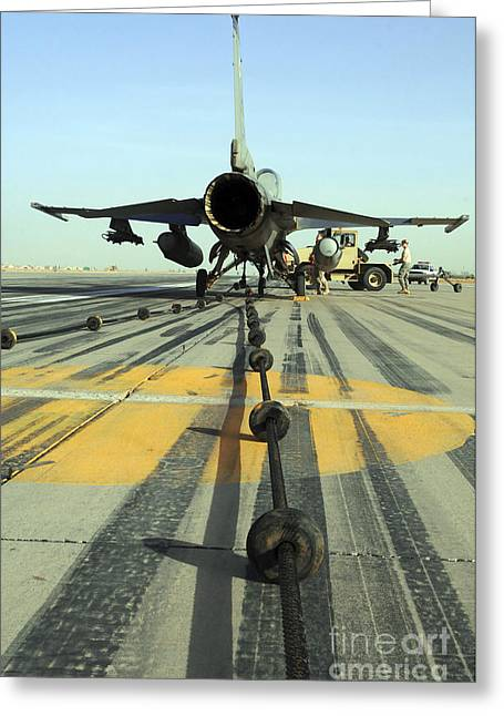Airbase Greeting Cards - An F-16 Fighting Falcon Waits Greeting Card by Stocktrek Images