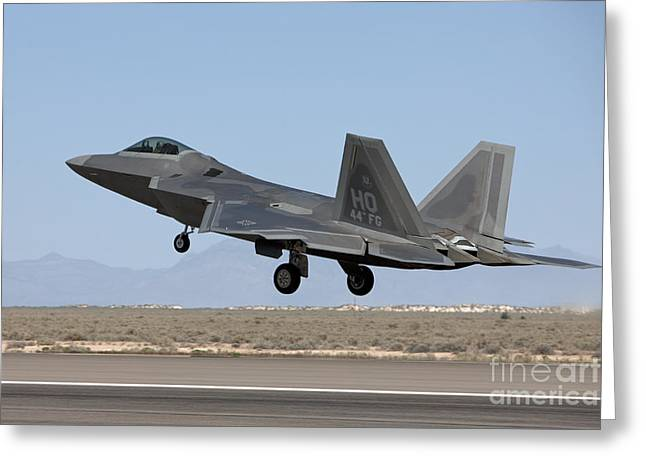 Airbase Greeting Cards - An F-22 Raptor Takes Off From Holloman Greeting Card by HIGH-G Productions