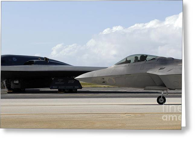 Two Spirit Greeting Cards - An F-22 Raptor Taxis While A B-2 Spirit Greeting Card by Stocktrek Images