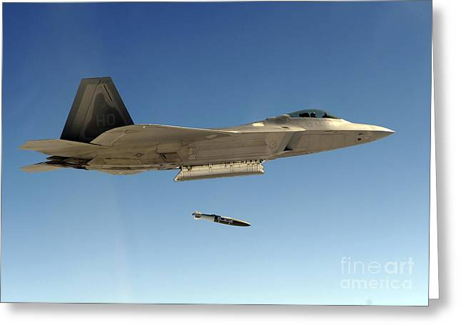 Dropping Greeting Cards - An F-22a Raptor Drops A Gbu-32 Bomb Greeting Card by Stocktrek Images