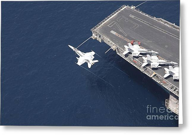 F-18 Greeting Cards - An Fa-18 Hornet Flys Over Aircraft Greeting Card by Stocktrek Images