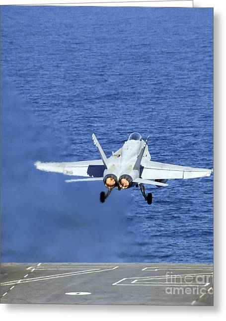 F-18 Greeting Cards - An Fa-18c Hornet Launches From The Uss Greeting Card by Stocktrek Images