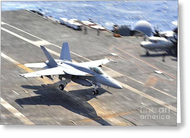 F-18 Greeting Cards - An Fa-18e Super Hornet Lands Aboard Greeting Card by Stocktrek Images