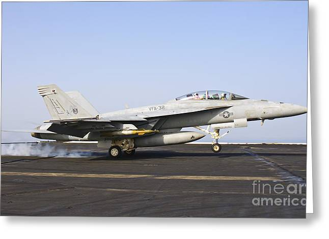 Braking Greeting Cards - An Fa-18e Super Hornet Lands Aboard Uss Greeting Card by Giovanni Colla