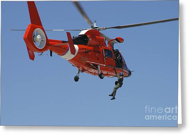 Law Enforcement Greeting Cards - An Hh-65c Dolphin Demonstrates Greeting Card by Stocktrek Images