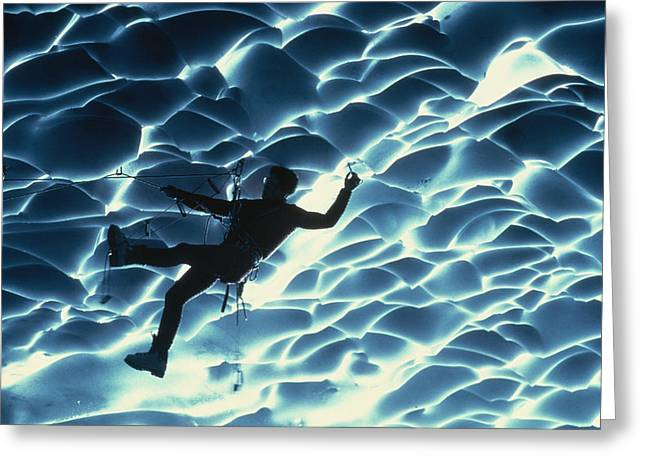 An Ice Climber Crosses The Ceiling Greeting Card by Carsten Peter
