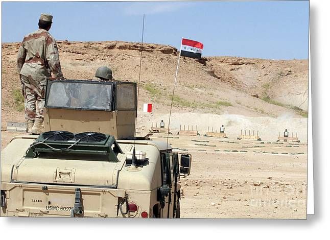 Hmmwv Greeting Cards - An Instructor Watches As An Iraqi Army Greeting Card by Stocktrek Images