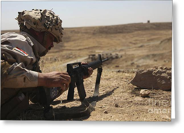 Iraqi Army Greeting Cards - An Iraqi Army Soldier Prepares To Fire Greeting Card by Stocktrek Images