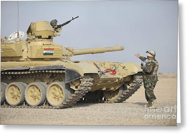 Iraqi Army Greeting Cards - An Iraqi Officer Directs A T-72 Tank Greeting Card by Stocktrek Images