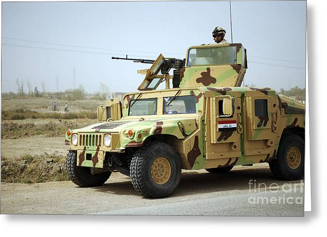 Hmmwv Greeting Cards - An Iraqi Soldier Provides Security Greeting Card by Stocktrek Images