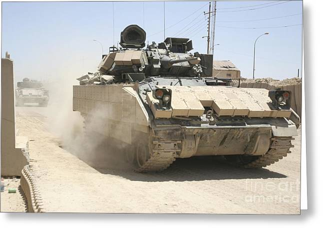 Us Army Tank Greeting Cards - An M2 Bradley Fighting Vehicle Patrols Greeting Card by Stocktrek Images