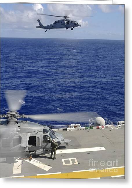 Uss Essex Greeting Cards - An Mh-60s Sea Hawk Helicopter Greeting Card by Stocktrek Images