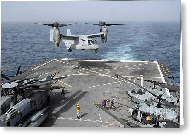 Mv Greeting Cards - An Mv-22b Osprey Lands Aboard Greeting Card by Stocktrek Images