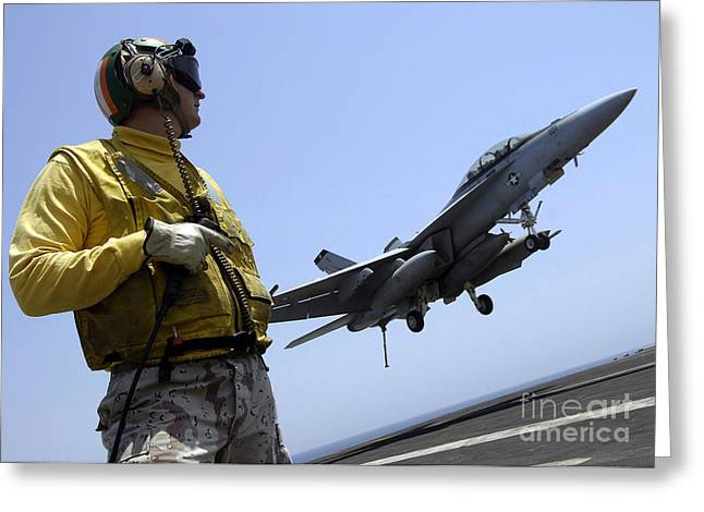 F-18 Greeting Cards - An Officer Observes An Fa-18f Super Greeting Card by Stocktrek Images