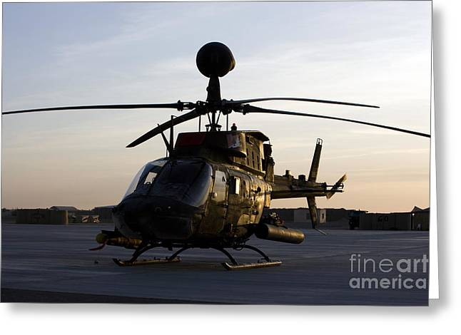 Helipad Greeting Cards - An Oh-58d Kiowa During Sunset Greeting Card by Terry Moore