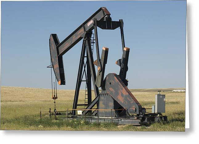 Digs Greeting Cards - An Oil Rig Pumps Oil From The Montana Greeting Card by Joel Sartore
