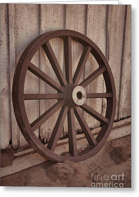 Old Western Photos Greeting Cards - An Old Wagon Wheel Greeting Card by Donna Van Vlack