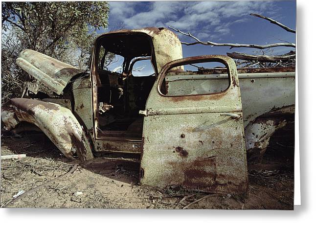 Doors And Doorways Greeting Cards - An Old Wrecked Truck In A Desert Greeting Card by Jason Edwards