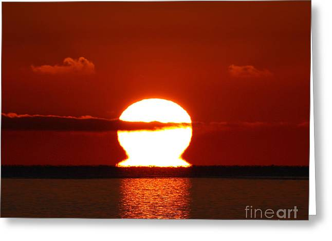 Ocean. Reflection Greeting Cards - An Omega-shaped Sunrise Above The Water Greeting Card by Luis Argerich