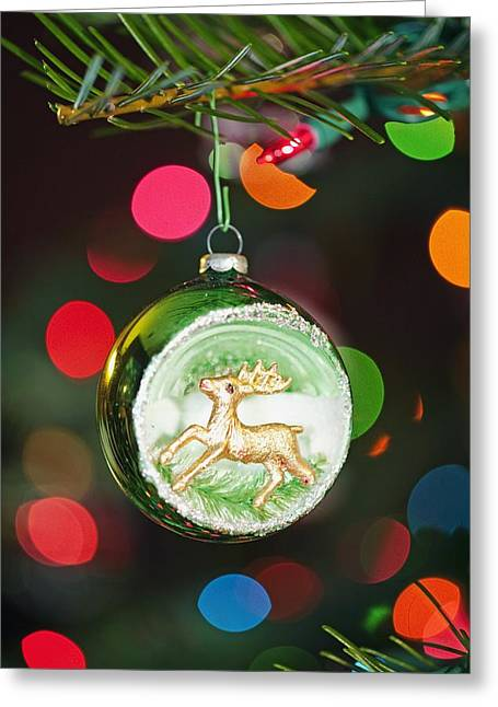 Festivities Greeting Cards - An Ornament With A Reindeer Hanging Greeting Card by Craig Tuttle