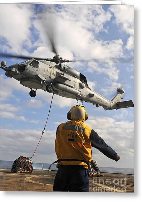 Hovering Greeting Cards - An Sh-60b Sea Hawk Helicopter Releases Greeting Card by Stocktrek Images