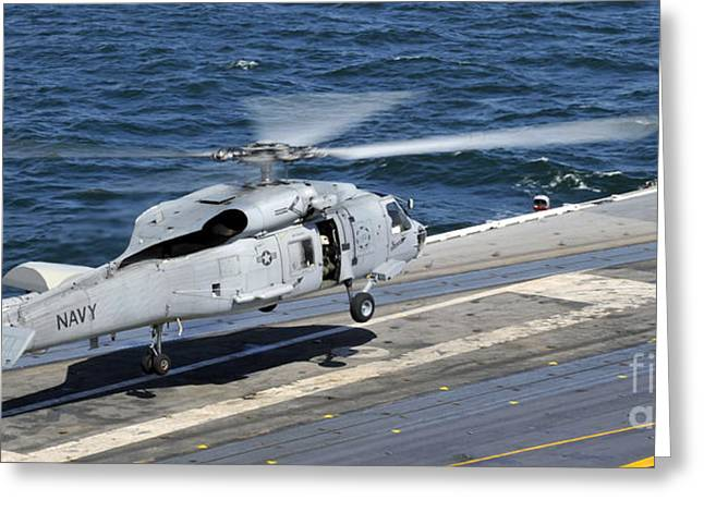 Nimitz-class Greeting Cards - An Sh-60f Sea Hawk Helicopter Lands Greeting Card by Stocktrek Images