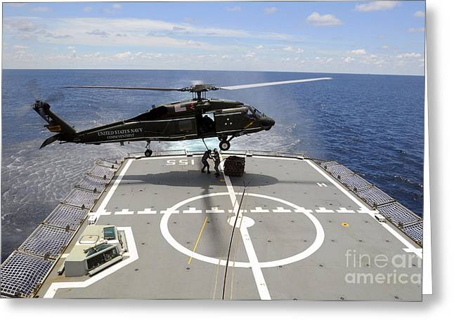 Royal Australian Navy Greeting Cards - An Sh-60f Sea Hawk Helicopter Lowers Greeting Card by Stocktrek Images