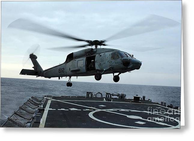 Helipad Greeting Cards - An Sh-60f Seahawk Helicopter Prepares Greeting Card by Stocktrek Images