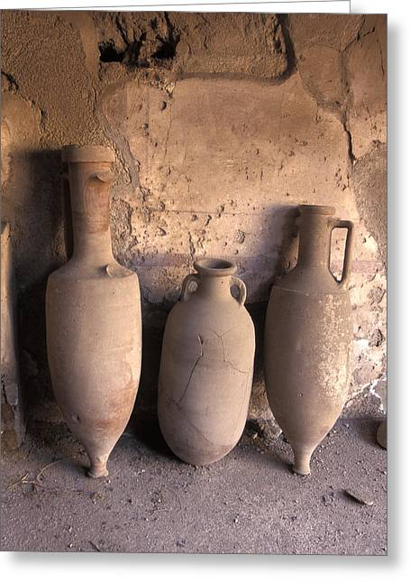 Wine Holder Photographs Greeting Cards - Ancient Wine Clay Vases  In A Wine Greeting Card by Richard Nowitz