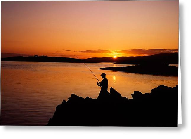 Angler At Sunset, Roaring Water Bay, Co Greeting Card by The Irish Image Collection