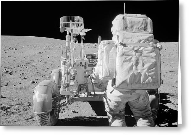Roving Greeting Cards - Apollo 16 Astronaut Reaches For Tools Greeting Card by Stocktrek Images
