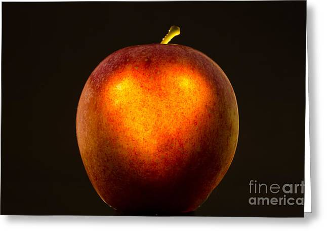 Passion Fruit Greeting Cards - Apple with a illuminated heart Greeting Card by Mats Silvan