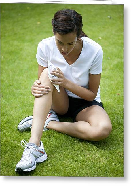 Mid Adult Women Greeting Cards - Applying Ice Pack To Injured Knee Greeting Card by
