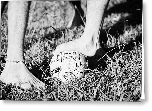 argentinian hispanic men start a football game barefoot in the park on grass Greeting Card by Joe Fox