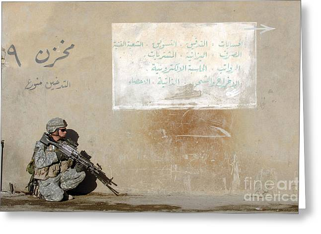 Operation Iraqi Freedom Greeting Cards - Army Specialist Kneeling Next To A Wall Greeting Card by Stocktrek Images