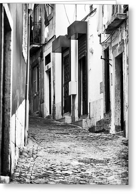 In The Corner Greeting Cards - Around the Corner in Alfama Greeting Card by John Rizzuto