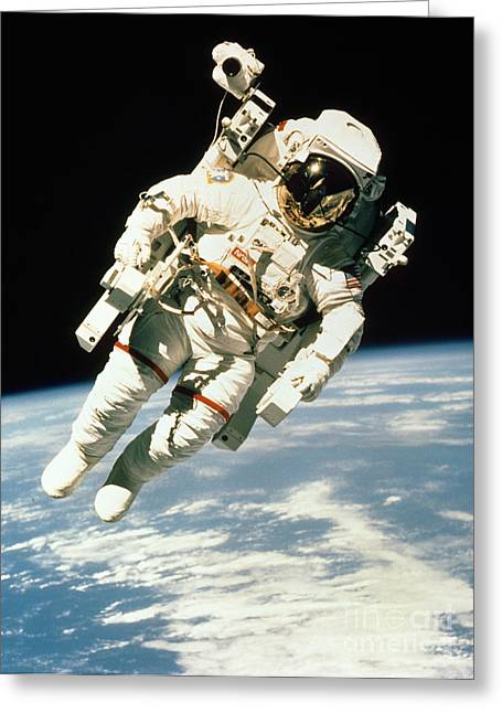 Astronaut In Space Greeting Card by NASA / Science Source