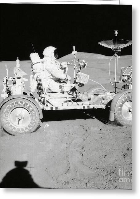 Roving Greeting Cards - Astronaut Is Seated In The Lunar Roving Greeting Card by Stocktrek Images