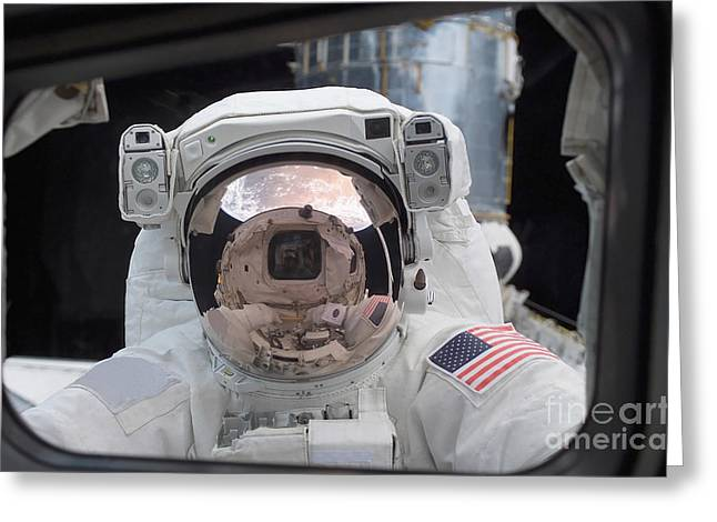 Cabin Window Greeting Cards - Astronaut Peers Into The Crew Cabin Greeting Card by Stocktrek Images