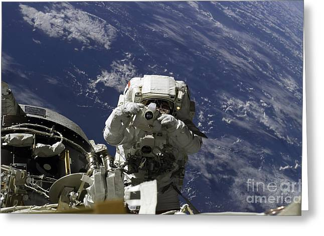 Space Photographs Greeting Cards - Astronaut Uses A Digital Still Camera Greeting Card by Stocktrek Images