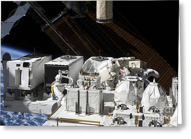 Maintenance Facility Greeting Cards - Astronaut Working On The Japanese Greeting Card by Stocktrek Images