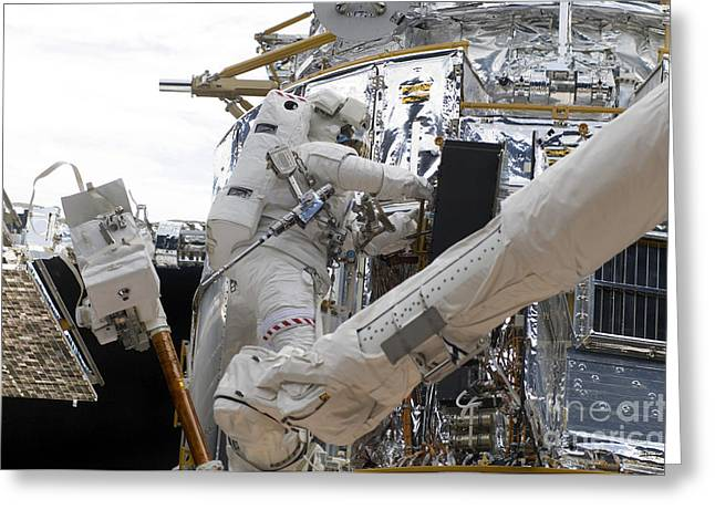 Component Greeting Cards - Astronauts Working On The Hubble Space Greeting Card by Stocktrek Images